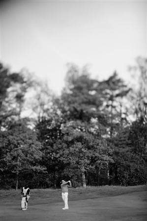 HILVERSUM, NETHERLANDS - SEPTEMBER 11:  (EDITORS NOTE: THIS BLACK AND WHITE IMAGE WAS CREATED FROM ORIGINAL COLOUR FILE AND A TILT AND SHIFT LENS WAS USED IN THE CREATION OF THIS IMAGE). Louis Oosthuizen of South Africa plays his approach shot on the first hole during the third round of  The KLM Open Golf at The Hillversumsche Golf Club on September 11, 2010 in Hilversum, Netherlands.  (Photo by Stuart Franklin/Getty Images)