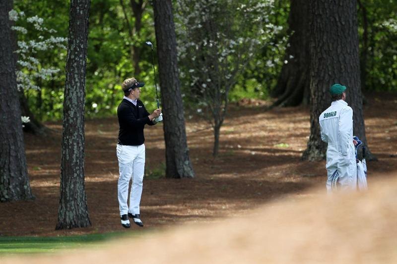 AUGUSTA, GA - APRIL 05:  Luke Donald of England jumps to watch his shot alongside his caddie John McLaren during a practice round prior to the 2011 Masters Tournament at Augusta National Golf Club on April 5, 2011 in Augusta, Georgia.  (Photo by Jamie Squire/Getty Images)