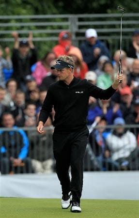 VIRGINIA WATER, ENGLAND - MAY 28:  Luke Donald of England celebrates holing a putt on the 16th green during the third round of the BMW PGA Championship at the Wentworth Club on May 28, 2011 in Virginia Water, England.  (Photo by David Cannon/Getty Images)