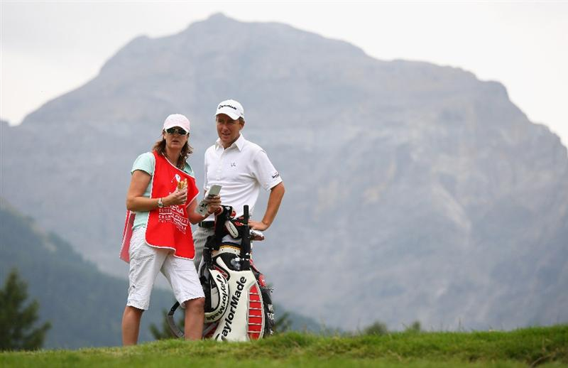 CRANS, SWITZERLAND - SEPTEMBER 06:  Mark Foster of England waits with his caddie Janet Squire on the 12th hole during the third round of the Omega European Masters at Crans-Sur-Sierre Golf Club on September 6, 2008 in Crans Montana, Switzerland.  (Photo by Andrew Redington/Getty Images)