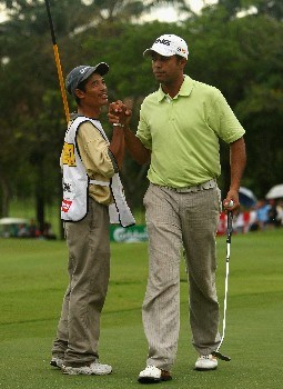 KUALA LUMPUR, MALAYSIA - MARCH 09:  Arjun Atwal of India celebrates with his caddie on the 18th hole during the final round of the Maybank Malaysian Open held at the Kota Permai Golf & Country Club on March 9, 2008 in Kuala Lumpur, Malaysia.  (Photo by Andrew Redington/Getty Images)