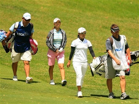 EDINA, MN - JUNE 28:  Momoko Ueda and Ai Miyazato of Japan walk off the third tee with their caddies during the third round of the 2008 U.S. Women's Open at Interlachen Country Club on June 28, 2008 in Edina, Minnesota.  (Photo by Scott Halleran/Getty Images)
