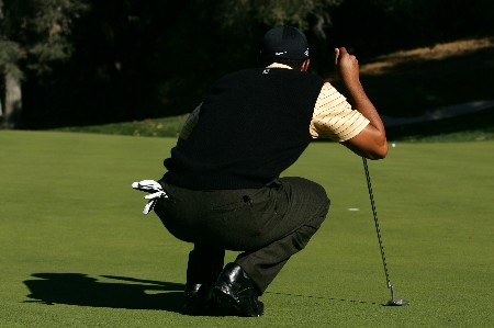 THOUSAND OAKS, CA - DECEMBER 15:  Tiger Woods aims for a putt during the third round of the Target World Challenge at the Sherwood Country Club on December 15, 2007 in Thousand Oaks, California.  (Photo by Robert Laberge/Getty Images)