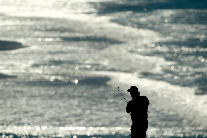 PEBBLE BEACH, CA - FEBRUARY 12:  Phil Mickelson hits his second shot on the 9th hole during the third round of the AT&T Pebble Beach National Pro-Am at the Pebble Beach Golf Links on February 12, 2011 in Pebble Beach, California.  (Photo by Ezra Shaw/Getty Images)