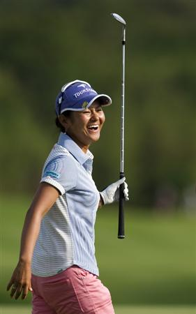 CHON BURI, THAILAND - FEBRUARY 21:  Ai Miyazato of Japan celebrates after sinking a chip shot on the 18th green during the final round of the Honda PTT LPGA Thailand at Siam Country Club on February 21, 2010 in Chon Buri, Thailand.  (Photo by Victor Fraile/Getty Images)