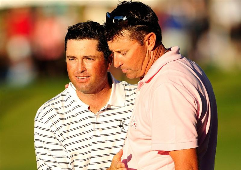 HONOLULU - JANUARY 17:  Ryan Palmer (L) and Robert Allenby of Australia walk off the 18th hole following the final round of the Sony Open at Waialae Country Club on January 17, 2010 in Honolulu, Hawaii.  (Photo by Sam Greenwood/Getty Images)