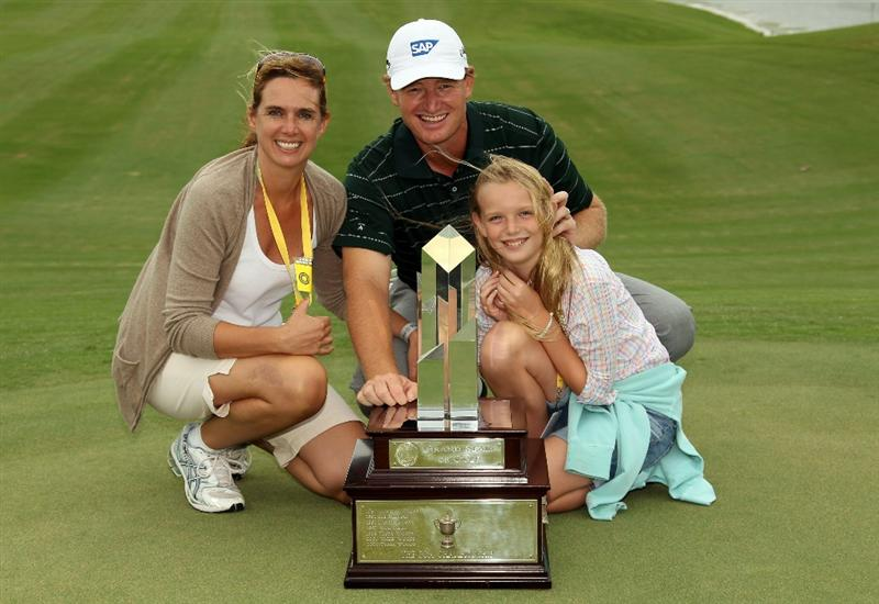 SOUTHAMPTON, BERMUDA - OCTOBER 20:  Ernie Els  of South Africa with the winners trophy is pictured with hs wife Liezl and daughter Samantha after the final round of the 2010 PGA Grand Slam of Golf at The Port Royal Golf Course on October 20, 2010 in Southampton, Bermuda.  (Photo by Ross Kinnaird/Getty Images)