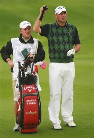 BAHRAIN, BAHRAIN - JANUARY 28:  Thomas Bjorn of Denmark waits with his caddie Dominic Bott on the 14th hole during the second round of the Volvo Golf Champions at The Royal Golf Club on January 28, 2011 in Bahrain, Bahrain.  (Photo by Andrew Redington/Getty Images)