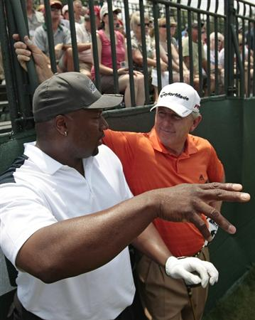 BIRMINGHAM, AL - MAY 14: Former NFL football star Bo Jackson (L) talks with Hale Irwin as they wait to tee off on the first hole during the Thursday Pro-AM of the Regions Charity Classic at the Robert Trent Jones Golf Trail at Ross Bridge on May 14, 2009  in Birmingham, Alabama. (Photo by Dave Martin/Getty Images)