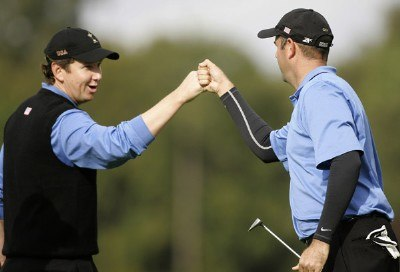 J.J. Henry and Stewart Cink of the USA celebrate winning the 10th hole during the morning Fourballs at the 2006 Ryder Cup held at the K Club, Straffan, County Kildare, Ireland on Saturday, September 23, 2006. Photo by Sam Greenwood/WireImage.com