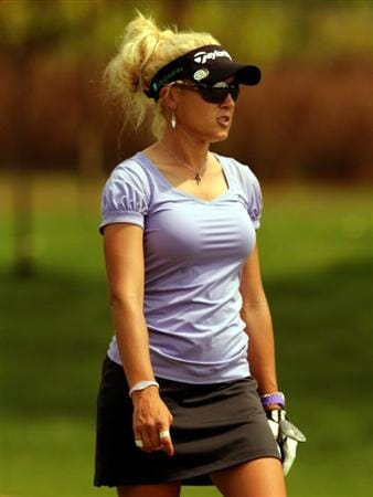 KUALA LUMPUR, MALAYSIA - OCTOBER 21:  Natalie Gulbis of USA walks towards the 6th hole during the Sime Darby Pro-Am at the KLGCC Golf Course on October 21, 2010 in Kuala Lumpur, Malaysia.  (Photo by Stanley Chou/Getty Images)