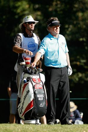 MADISON, MS - OCTOBER 03:  Michael Allen (R) prepares to play his tee shot on the 15th hole during the final round of the Viking Classic held at Annandale Golf Club on October 3, 2010 in Madison, Mississippi.  (Photo by Michael Cohen/Getty Images)
