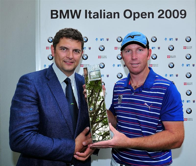 TURIN, ITALY - MAY 10:  Daniel Vancsik of Argentina is presented with the winners trophy by Gianni Castronovo, C.E.O of BMW Italy, after winning the BMW Italian Open at Royal Park I Roveri on May 10, 2009 near Turin, Italy.  (Photo by Stuart Franklin/Getty Images)