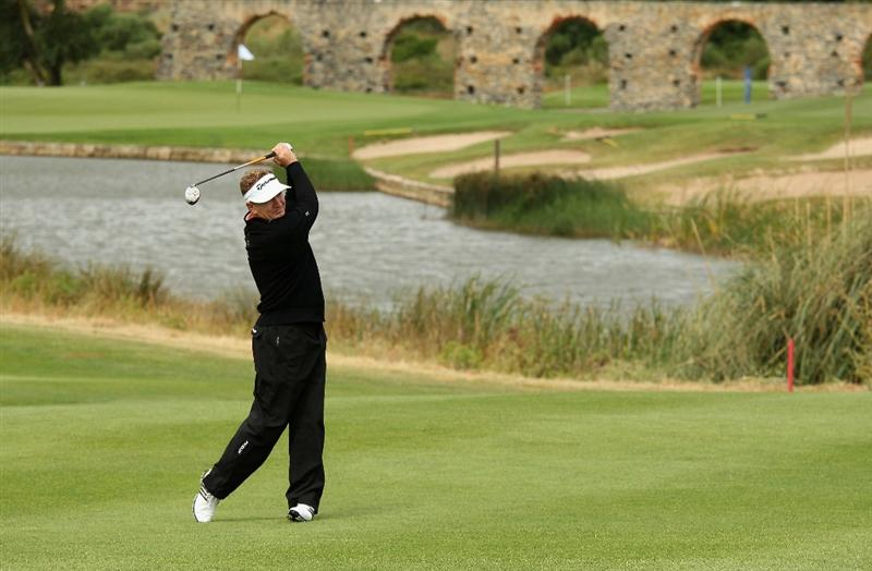 ESTORIL, PORTUGAL - JUNE 09:  Paul Broadhurst of England plays his second shot into the eighth green during the Pro-am of the Estoril Open de Portugal at Penha Longa Golf Club on June 9, 2010 in Estoril, Portugal.  (Photo by Warren Little/Getty Images)