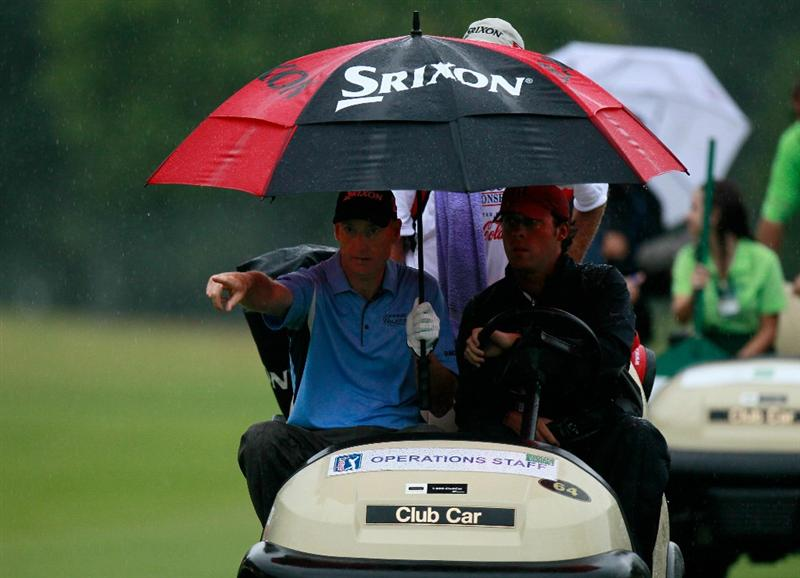 ATLANTA - SEPTEMBER 26:  Jim Furyk rides with an official and his caddie after play was suspended for dangerous weather during the final round of THE TOUR Championship presented by Coca-Cola at East Lake Golf Club on September 26, 2010 in Atlanta, Georgia.  (Photo by Kevin C. Cox/Getty Images)