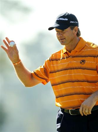 AUGUSTA, GA - APRIL 07:  Retief Goosen of South Africa waves to the gallery after making eagle on the first hole during the first round of the 2011 Masters Tournament at Augusta National Golf Club on April 7, 2011 in Augusta, Georgia.  (Photo by Jamie Squire/Getty Images)