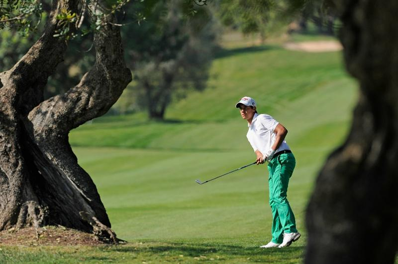 CASTELLON DE LA PLANA, SPAIN - OCTOBER 24:  Matteo Manassero of Italy plays his approach shot on the eighth hole during the final round of the Castello Masters Costa Azahar at the Club de Campo del Mediterraneo on October 24, 2010 in Castellon de la Plana, Spain.  (Photo by Stuart Franklin/Getty Images)