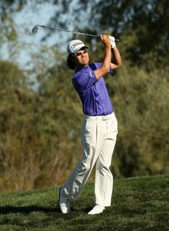 SCOTTSDALE, AZ - JANUARY 31:  Kevin Na hits his second shot on the second hole during the third round of the FBR Open on January 31, 2009 at TPC Scottsdale in Scottsdale, Arizona.  (Photo by Stephen Dunn/Getty Images)