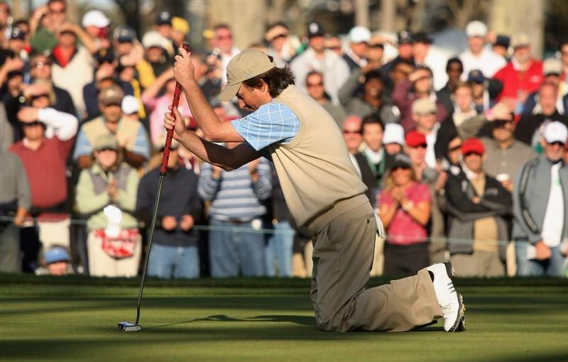 SAN FRANCISCO - OCTOBER 09:  Tim Clark of the International Team drops to his knees after winning his fourball match against Lucas Glover and Stewart Cink of the USA Team during the Day Two Fourball Matches of The Presidents Cup at Harding Park Golf Course on October 9, 2009 in San Francisco, California.  (Photo by Warren Little/Getty Images)