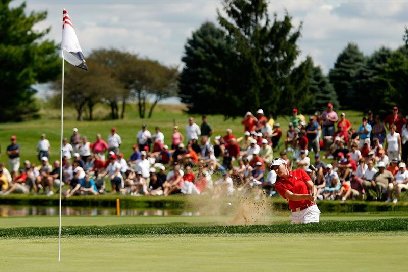 SUGAR GROVE, IL - AUGUST 23:  Brittany Lang of the U.S. Team tees chips out of a bunker on the 15th hole during  the 2009 Solheim Cup at Rich Harvest Farms on August 23, 2009 in Sugar Grove, Illinois.  (Photo by Chris Graythen/Getty Images)