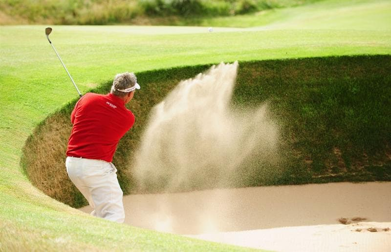 TURNBERRY, SCOTLAND - JULY 19:  Darren Clarke of Northern Ireland hits out of a bunker on the 15th hole during the final round of the 138th Open Championship on the Ailsa Course, Turnberry Golf Club on July 19, 2009 in Turnberry, Scotland.  (Photo by Stuart Franklin/Getty Images)