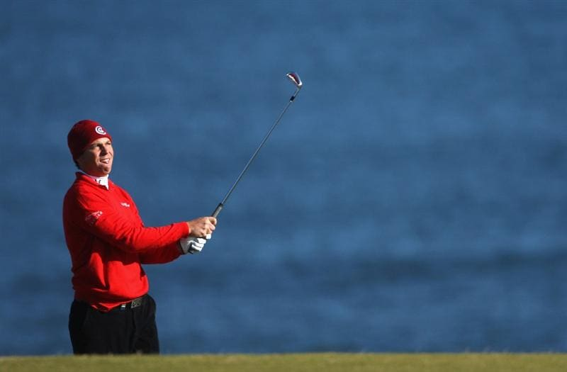 KINGSBARNS, SCOTLAND - OCTOBER 04:  David Howell of England plays his second shot to the fifth green during the third round of The Alfred Dunhill Links Championship at Kingsbarns Golf Links on October 4, 2009 in Kingsbarns, Scotland.The third round was postponed on Saturday due to gale force winds.  (Photo by Andrew Redington/Getty Images)
