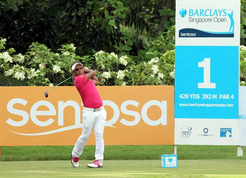SINGAPORE - NOVEMBER 14: Thongchai Jaidee of Thailand tees off on the 1st hole during the Final Round of the Barclays Singapore Open held at the Sentosa Golf Club on November 14, 2010 in Singapore, Singapore.  (Photo by Stanley Chou/Getty Images)