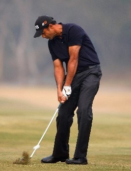 DELHI, INDIA - FEBRUARY 05:  Arjun Atwal of India plays an approach shot during practice round of The EMAAR - MGF Indian Masters at Delhi golf Club on February 05, 2008 in Delhi, India.  (Photo by Stuart Franklin/Getty Images)