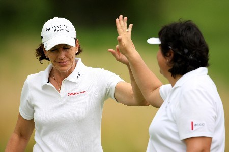SUN CITY, SOUTH AFRICA - JANUARY 18:  Juli Inkster and Pat Hurst of the USA celebrate a birdie on the 5th during the first round of the Women's World Cup of Golf at The Gary Player Country Club on January 18, 2008 in Sun City, South Africa.  (Photo by Richard Heathcote/Getty Images)