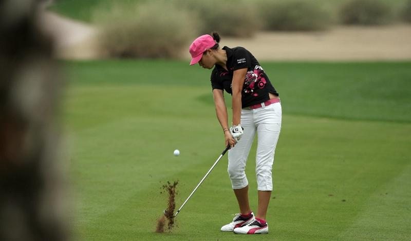 DUBAI, UNITED ARAB EMIRATES - DECEMBER 12:  Jade Schaeffer of France plays her second shot at the 16th hole during the final round of the Dubai Ladies Masters, on the Majilis Course at the Emirates Golf Club on December 12, 2009 in Dubai, United Arab Emirates.  (Photo by David Cannon/Getty Images)