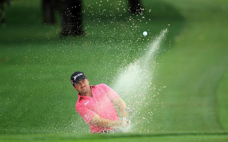 ORLANDO, FL - MARCH 24:  Graeme McDowell of Northern Ireland plays his third shot at the 15th hole during the first round of the 2011 Arnold Palmer Invitational presented by Mastercard at the Bay Hill Lodge and Country Club on March 24, 2011 in Orlando, Florida.  (Photo by David Cannon/Getty Images)
