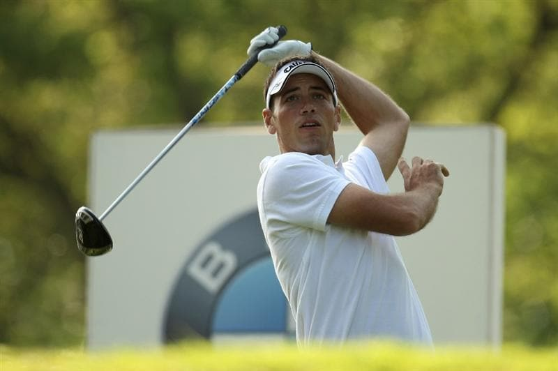 VIRGINIA WATER, ENGLAND - MAY 20:  Nick Dougherty of England reacts to his tee shot on the 17th hole during the first round of the BMW PGA Championship on the West Course at Wentworth on May 20, 2010 in Virginia Water, England.  (Photo by Ross Kinnaird/Getty Images)