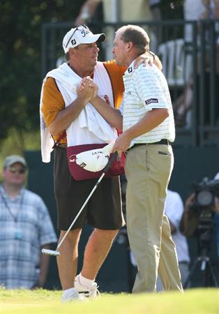 FT. WORTH, TX - MAY 31: Steve Stricker gets a hug from his caddie after winning on the second playoff hole during the final round of the Crowne Plaza Invitational at Colonial Country Club on May 31, 2009 in Ft. Worth, Texas. (Photo by Hunter Martin/Getty Images)