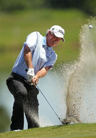 LUTZ, FL - APRIL 17:  Russ Cochran hits out of a bunker on the 15th hole during the final round of the Outback Steakhouse Pro-Am at the TPC of Tampa on April 17, 2011 in Lutz, Florida.  (Photo by Mike Ehrmann/Getty Images) BESTPIX