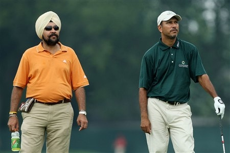 BLOOMFIELD HILLS, MI - AUGUST 05:  Prayad Marksaeng of Thailand (R) stands with his coach during a practice round prior to the 90th PGA Championship at Oakland Hills Country Club on August 5, 2008 in Bloomfield Township, Michigan.  (Photo by David Cannon/Getty Images)