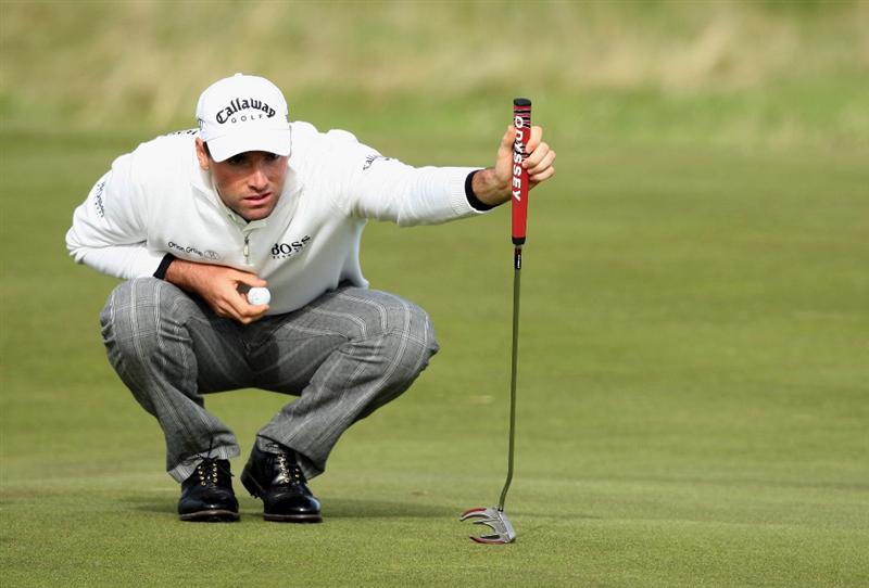 ST ANDREWS, SCOTLAND - OCTOBER 05:  Oliver Wilson of England lines up his putt on the 15th green during the final round of The Alfred Dunhill Links Championship at The Old Course on October 5, 2009 in St.Andrews, Scotland.  (Photo by David Cannon/Getty Images)