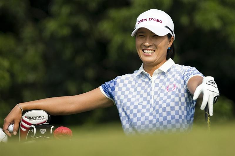 HAIKOU, CHINA - OCTOBER 30:  Se Ri Pak of South Korea smiles on the 18th tee during day four of the Mission Hills Start Trophy tournament at Mission Hills Resort on October 30, 2010 in Haikou, China. The Mission Hills Star Trophy is Asia's leading leisure liflestyle event and features Hollywood celebrities and international golf stars.  (Photo by Victor Fraile/Getty Images for Mission Hills)