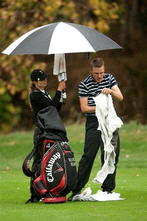 DANVILLE, CA - OCTOBER 17: Beatriz Recari of Spain holds an umbrella as caddie Andreas Thorp dons rain gear during the final round of the CVS/Pharmacy LPGA Challenge at Blackhawk Country Club on October 16, 2010 in Danville, California. (Photo by Darren Carroll/Getty Images)