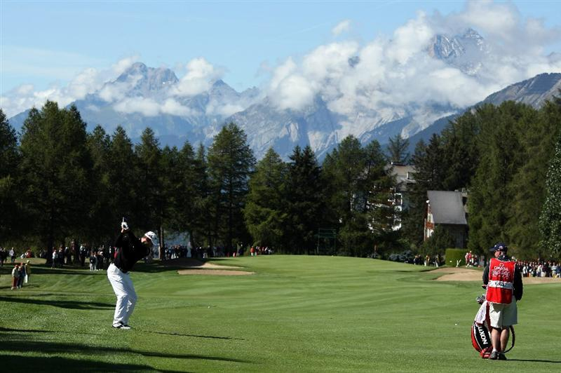 CRANS, SWITZERLAND - SEPTEMBER 05:  Bradley Dredge of Wales plays his second shot on the first hole during the third round of The Omega European Masters at Crans-Sur-Sierre Golf Club on September 5, 2009 in Crans Montana, Switzerland.  (Photo by Andrew Redington/Getty Images)