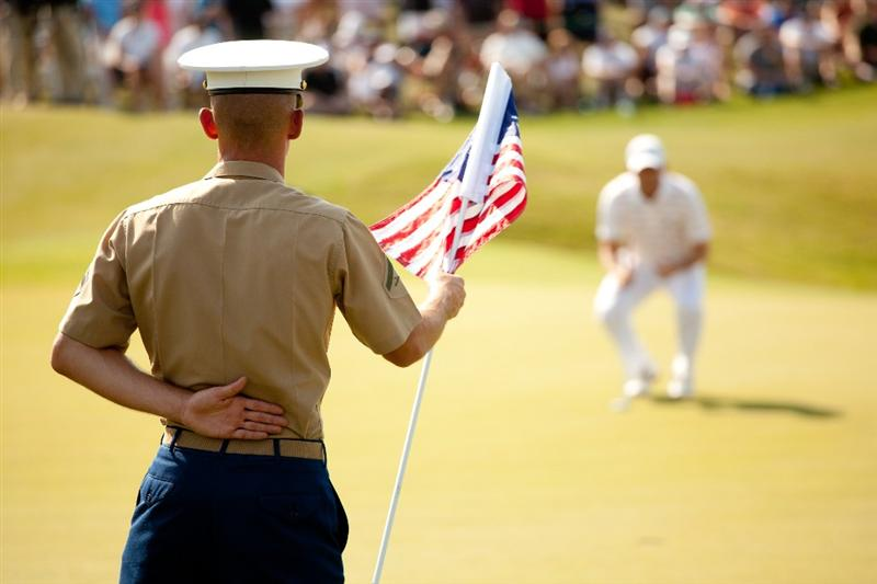 IRVING, TX - MAY 28: A U.S. Marine holds the flagstick at the 18th hole as Sergio Garcia of Spain lines up a putt during the third round of the HP Byron Nelson Championship at TPC Four Seasons at Las Colinas on May 28, 2011 in Irving, Texas. (Photo by Darren Carroll/Getty Images)