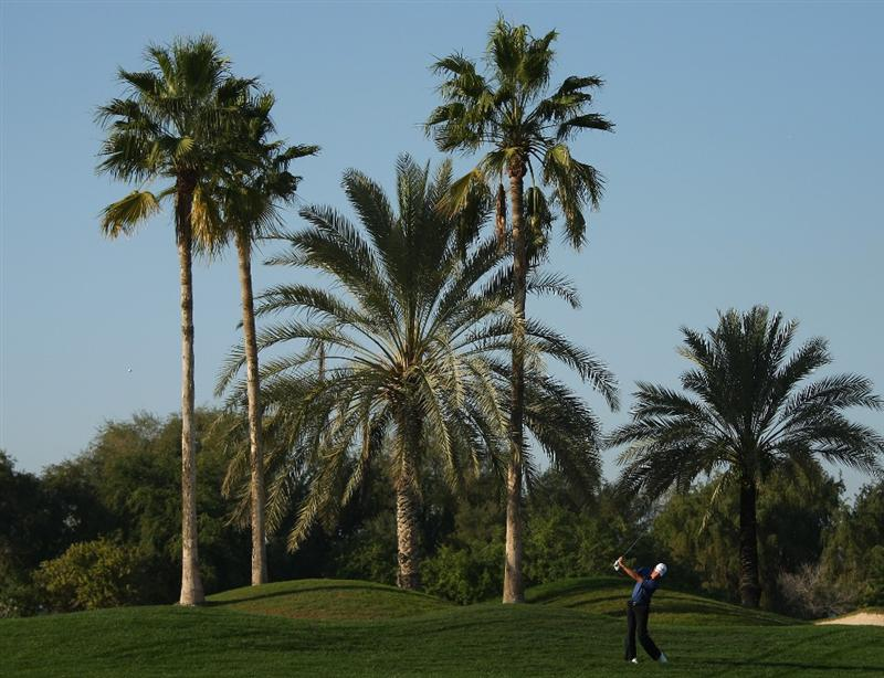 DUBAI, UNITED ARAB EMIRATES - JANUARY 31:  Richard Green of Australia hits his second shot on the fifth hole during the third round of the Dubai Desert Classic on the Majilis course at Emirates Golf Club on January 31, 2009 in Dubai, United Arab Emirates.  (Photo by Andrew Redington/Getty Images)