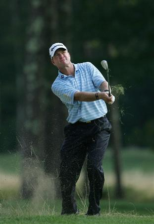 NORTON, MA - SEPTEMBER 05:  Scott Verplank of the United States plays a shot from the rough during the second round of the Deutsche Bank Championship at TPC Boston held on September 5, 2009 in Norton, Massachusetts.  (Photo by Michael Cohen/Getty Images)