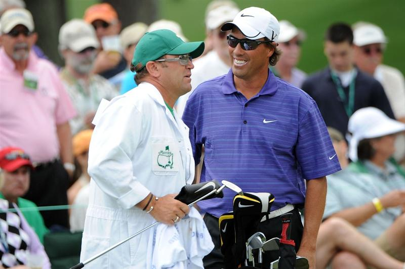 AUGUSTA, GA - APRIL 11:  Stephen Ames and his caddie Dean Eilliot talk about a shot on the second green during the third round of the 2009 Masters Tournament at Augusta National Golf Club on April 11, 2009 in Augusta, Georgia.  (Photo by Harry How/Getty Images)