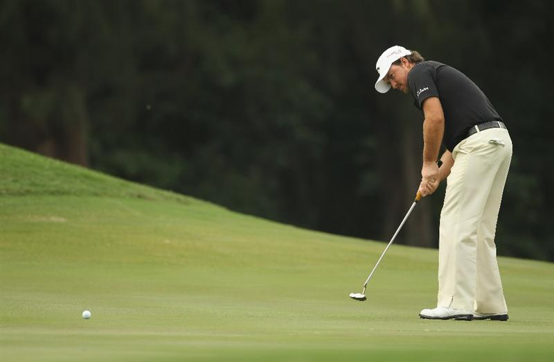 HONG KONG - NOVEMBER 20:  Graeme McDowell of Northern Ireland putts during day three of the UBS Hong Kong Open at The Hong Kong Golf Club on November 20, 2010 in Hong Kong, Hong Kong.  (Photo by Ian Walton/Getty Images)