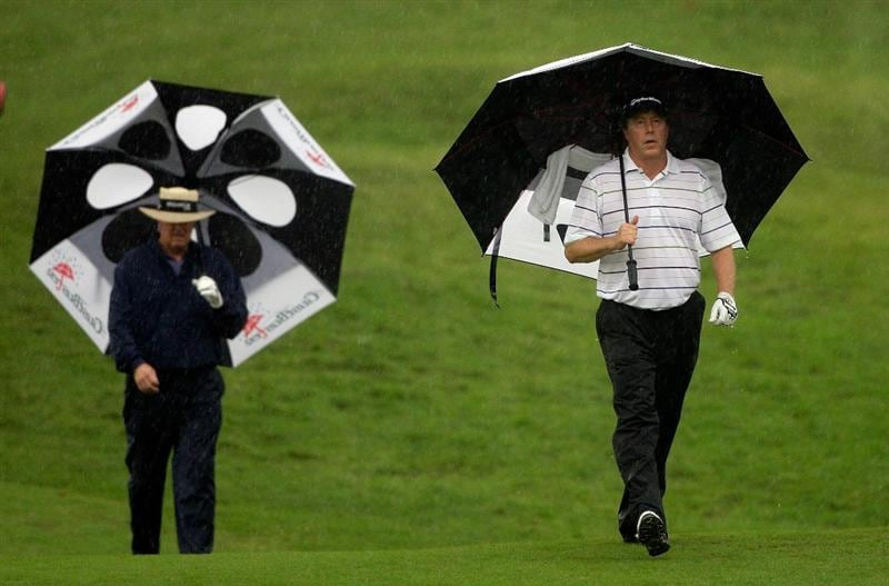 INCHEON, SOUTH KOREA - SEPTEMBER 10:  (L to R) Denis Watson of zimbabwe and Michael Allen of United States walk on the ninth hole during day one of PGA Champions Tour - Posco E&C Songdo Championship at Jack Nicklaus Golf Club on September 10, 2010 in Incheon, South Korea.  (Photo by Chung Sung-Jun/Getty Images)