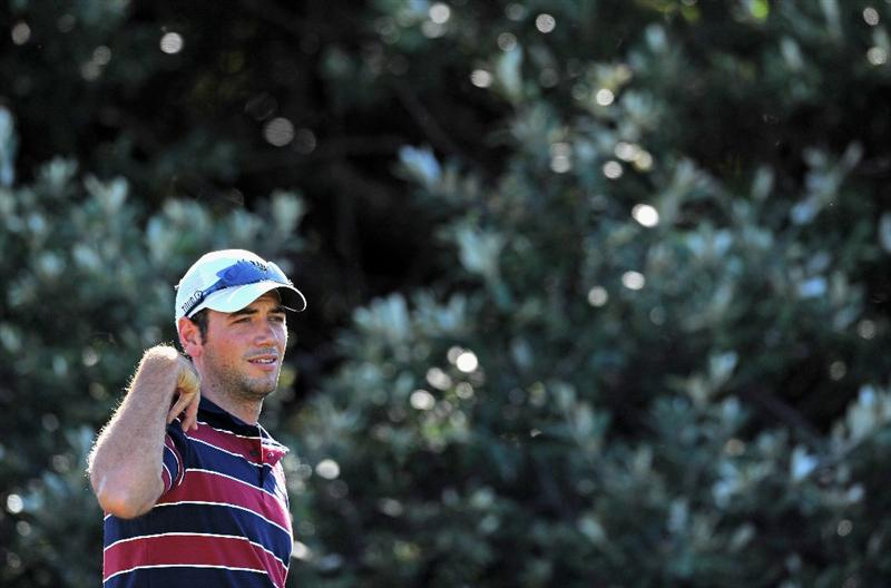 EAST LONDON, SOUTH AFRICA - JANUARY 07:  Nick Dougherty of England reacts to his tee shot on the 12th hole during the first round of the Africa Open at the East London Golf Club on January 7, 2010 in East London, South Africa.  (Photo by Stuart Franklin/Getty Images)
