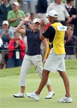EDINA, MN - JUNE 28: Stacy Lewis of the USA celebrates a birdie at the 18th hole with her father Dale Lewis during the third round of the 2008 U.S. Women's Open Championship held at Interlachen Country Club on June 28, 2008 in Edina, Minnesota.  (Photo by David Cannon/Getty Images)