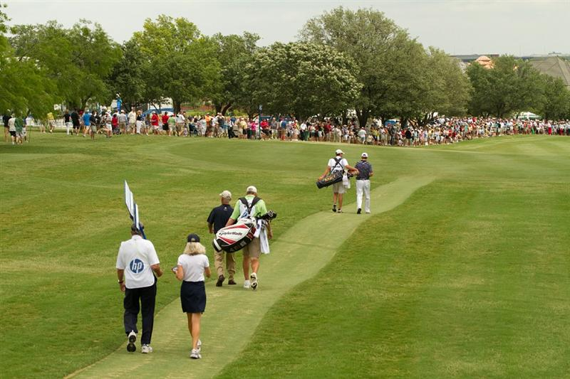 IRVING, TX - MAY 23: Jordan Spieth (R), Corey Pavin (3L), caddies and scoring volunteers walk down the first fairway during the fourth round of the HP Byron Nelson Championship at TPC Four Seasons Resort Las Colinas on May 23, 2010 in Irving, Texas. (Photo by Darren Carroll/Getty Images)