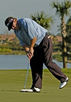 Joey Sindelar putts on  the 17th green during first round competition at the 2005 Honda Classic March 10, 2005 in Palm Beach Gardens, Florida.