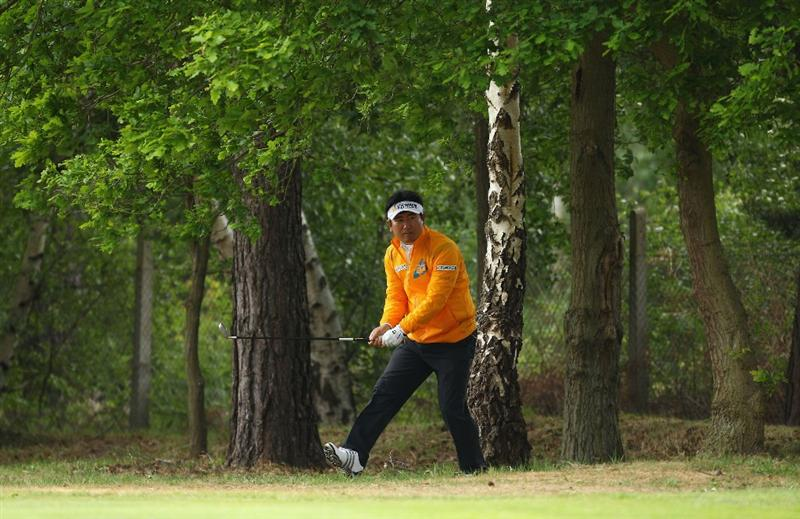 VIRGINIA WATER, ENGLAND - MAY 26: YE Yang of Korea plays out of the trees during the first round of the BMW PGA Championship at Wentworth Club on May 26, 2011 in Virginia Water, England.  (Photo by Richard Heathcote/Getty Images)